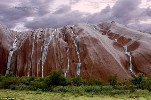 cascading rain on rock uluru